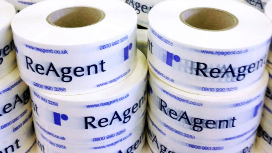 Rolls of ReAgent branded packing tape stacked next to each other
