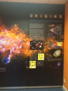 The award-winning ORIGINS poster