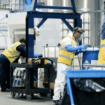 People working in chemical manufacturing facility