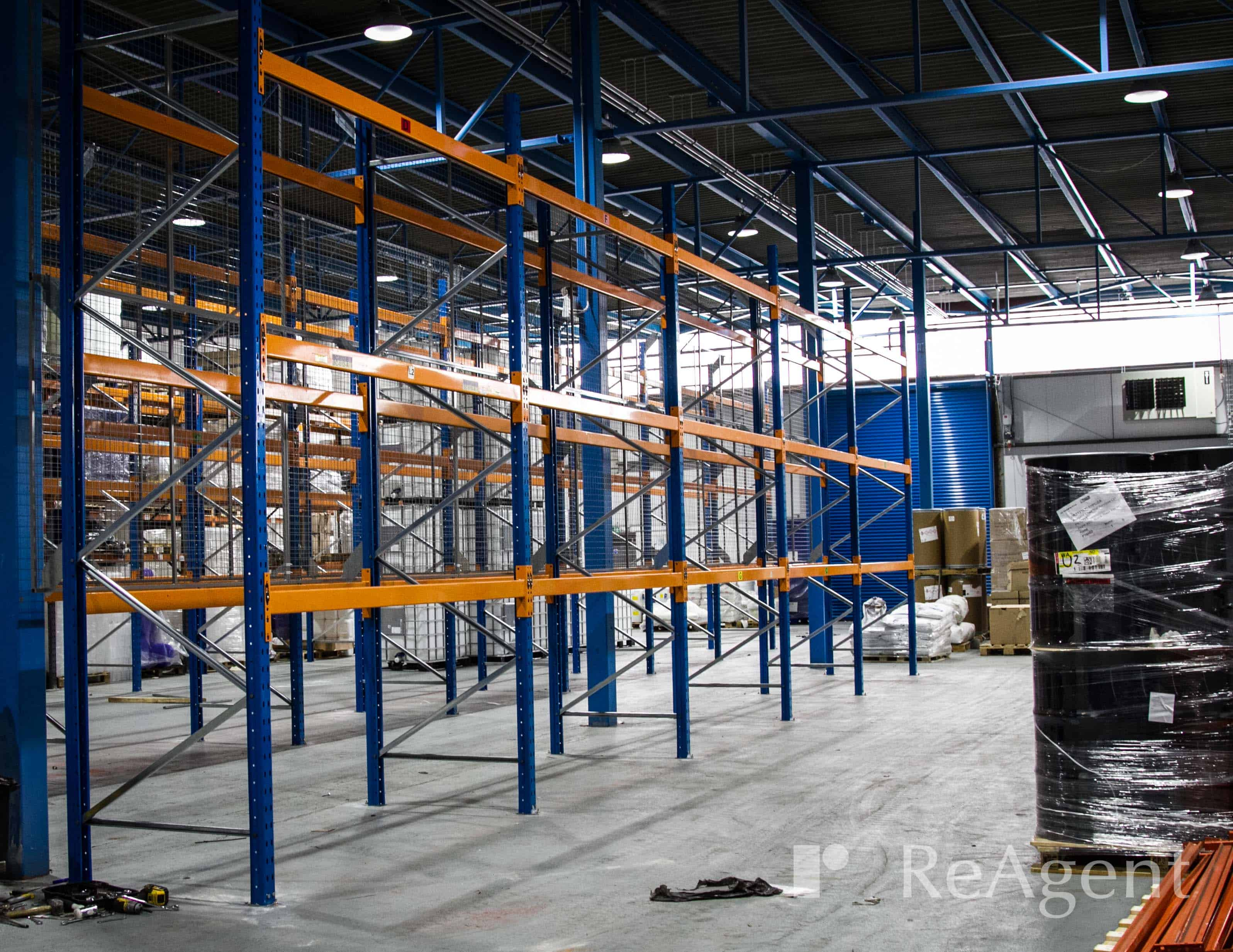 Blue and orange pallet racking in a factory