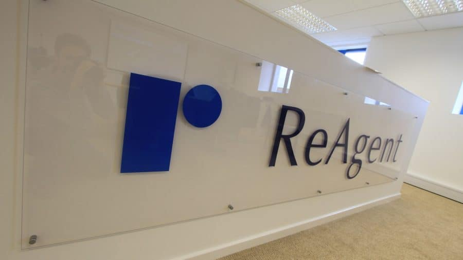 A close up of the ReAgent logo in an office